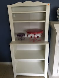 white wood-framed side table with hutch