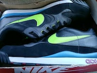 pair of black-and-green Nike running shoes Manassas, 20109