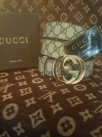 white leather Gucci belt with silver-colored buckle