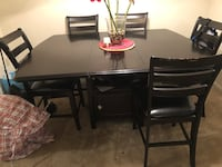 rectangular black wooden table with four chairs dining set Woodbridge, 22191