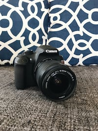 Black canon eos dslr camera Rebel T5
