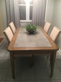 Brown wooden dining set and green plant Haledon, 07508