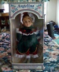 girl in white and red dress doll Brantford, N3T 5M1