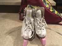 pair of white-and-pink inline skates 766 km