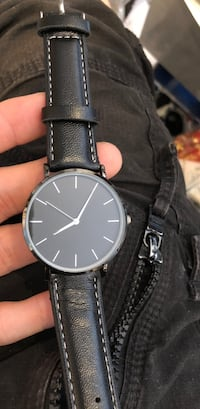 round black analog watch with black leather strap Laval, H7S 2M7