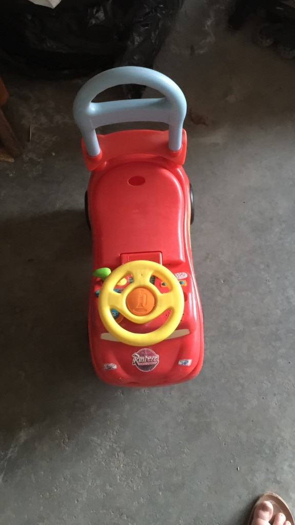 children's red and gray ride on toy