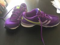pair of purple-and-white Nike running shoes