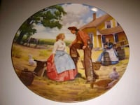 round brown wooden framed painting of people 728 mi
