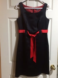 Black with a red belt sleeveless dress.Size 8.perfect for up coming party.