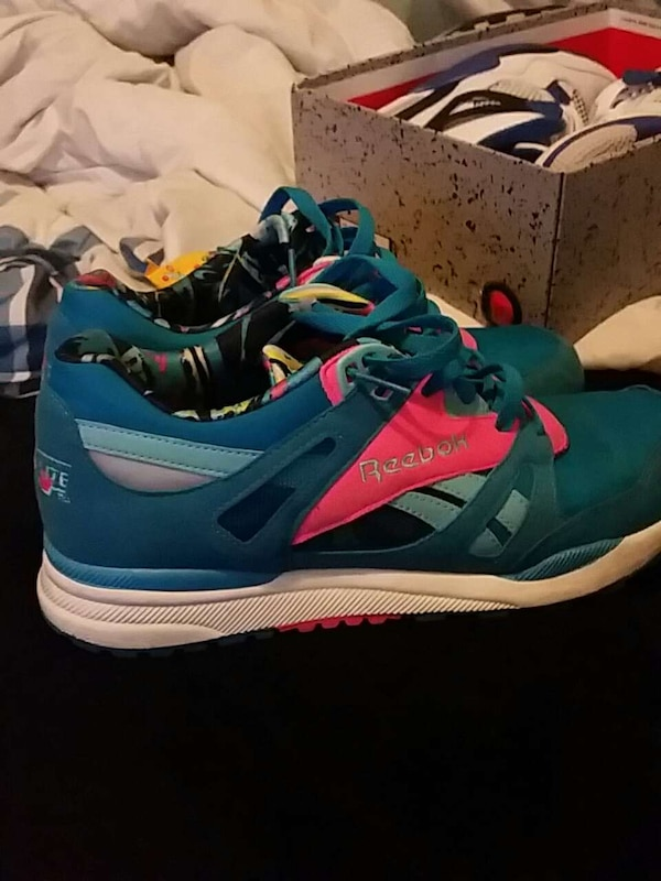 Used pair of green-and-pink Reebok running shoes for sale