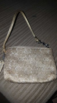 """Gold and brown """"c"""" themed coach wristlet cute Bethesda, 20817"""