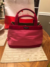 KATE SPADE HANDBAG HAS A COUPLE OF SPOTS CAN BE WIPED OFF WRINKLES DUE TO BEING IN A DRAWER EXCELLENT CONDITION OTHERWISE PICK UP WEST MOBILE DAWES RD  Grand Bay, 36541