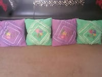 four purple-and-green floral throw pillows
