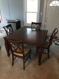 rectangular brown wooden table with four chairs dining set Indianapolis, 46220