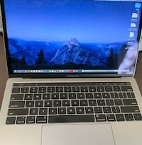 13-inch Macbook Pro With i7 has Touchbar and ID