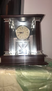black and white pendulum clock 57 km
