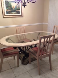 Marble and glass table with wrought iron base. With or without chairs   Brampton, L7A 1H2