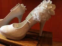 Pair of white wedding shoes 798 km