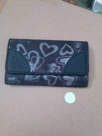 round silver-colored coin and brown and black leather wallet Brownsville, N0L 1C0