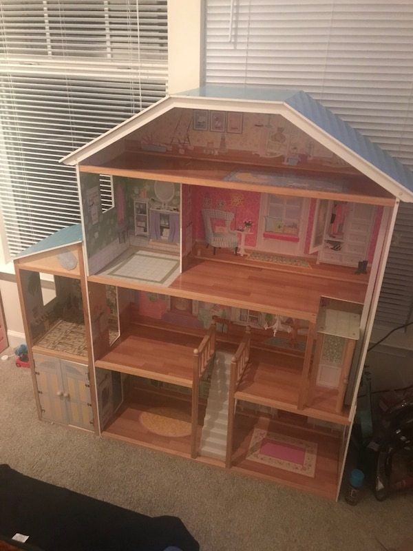 Brown wooden 3-storey dollhouse. Like new, 4'5 in height, no damage what so ever. Pick up only, as it is too big to ship