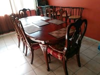 round brown wooden table with four chairs dining s 2277 mi
