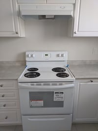 Brand New Frigidaire Oven and Stove with Range Hood
