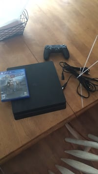 Black sony ps4 console with controller and game case Wilmington, 01887