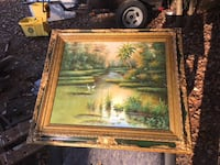 brown framed with river painting