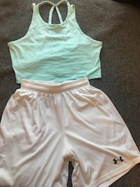 green sports bra and white Under Armour shorts