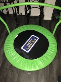 green and black Little Tikes trampoline