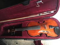 Brown violin with bow and case