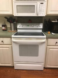 white and black induction range oven 778 mi