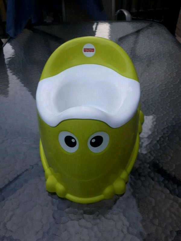 yellow and green Fisher-Price potty trainer