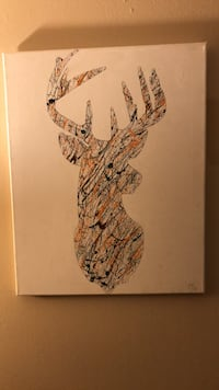 Hand painted with camouflage colored paint plus safety orange in design shape of a buck. Lexington, 40517