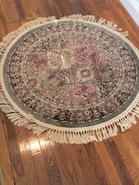Round pink and white floral tapestry