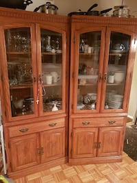 two brown wood-framed glass display cabinet