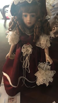 two white and one brown dressed female dolls Margate, 33063