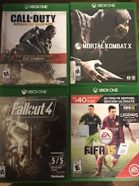four Microsoft Xbox One game cases