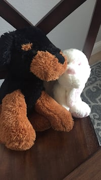 two brown and white dog plush toys