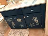 Coastal blue cabinetry with seaside design a gray top with seaside design matching bottom very chicly done Bradenton, 34205