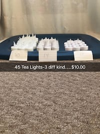 white tealight candle lot with text overlay