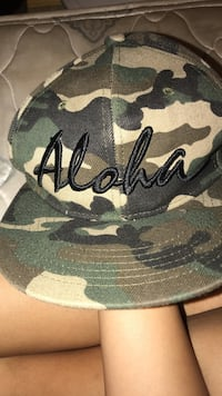 Green, black, and brown camouflage cap Wahiawa, 96786