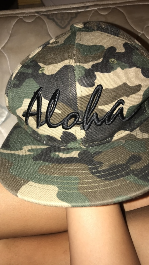 Green, black, and brown camouflage cap