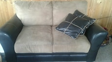brown suede loveseat with black leather base