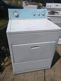 white top load washing machine and dryer