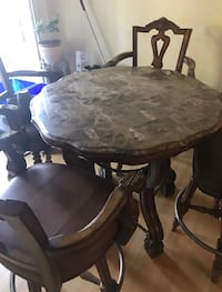 Round brown wooden table with four chairs dining set Germantown, 20876