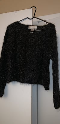 Black sweater with gold flakes.