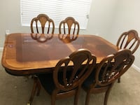 brown wooden dining table set 772 mi