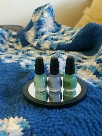 Double sided cosmetic mirror and nail polishes