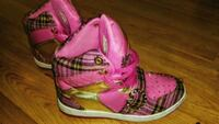 pair of Apple Bottom pink high-top shoes